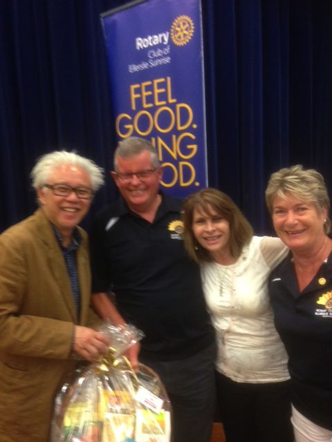 Ron Seeto receiving his lucky hamper with the Rotary Club team from Ellerslie at the ERA Clubs and Societies Marketplace night last Monday 21st November, 2016 at the Ellerslie war memorial hall Main Highway Ellerslie.